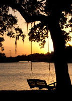 Eau Gallie Harbour sunset with silhouette of swing