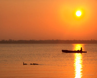 Kayak and ducks at sunrise on Indian River